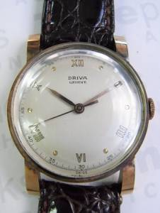 DRIVA hand winding center second gold
